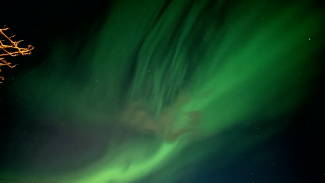 timelapse of explosion of solar storm or aurora borealis, northern lights with stars in night sky - weather stock videos & royalty-free footage