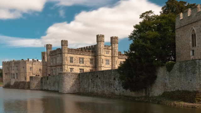 time-lapse of exterior of leeds castle and moat in england. - moat stock videos and b-roll footage