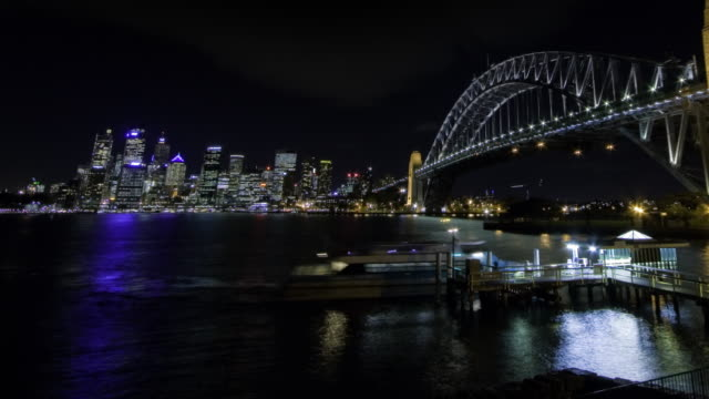 time-lapse of ferries docking at north shore of sydney harbour at night - international landmark stock videos & royalty-free footage