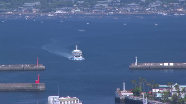 hd: timelapse of ferry arriving at terminal (video) - ferry stock videos & royalty-free footage