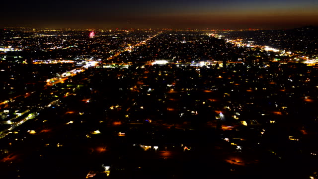 timelapse of fireworks from aerial view - dusk stock videos & royalty-free footage
