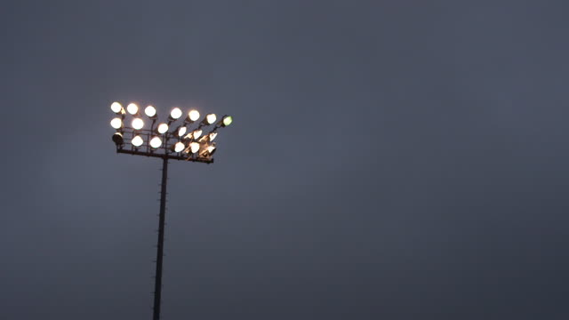 timelapse of floodlights transitioning from dusk to night at bethpage ballpark, ny - floodlight stock videos & royalty-free footage