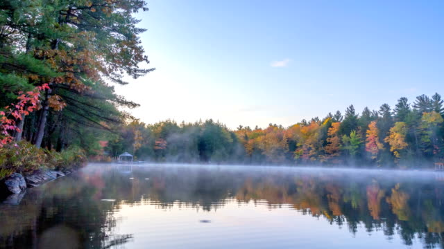 4k time-lapse of fog and multi colors autumn at lake muskoka, gravenhurst, canada - ontario canada stock videos & royalty-free footage