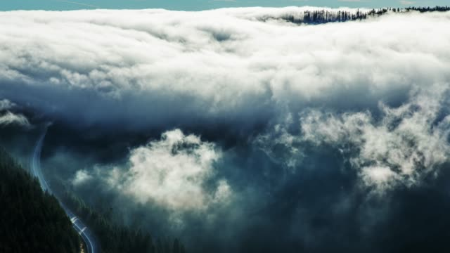 timelapse of fog rolling over mountain landscape - rolling stock videos & royalty-free footage
