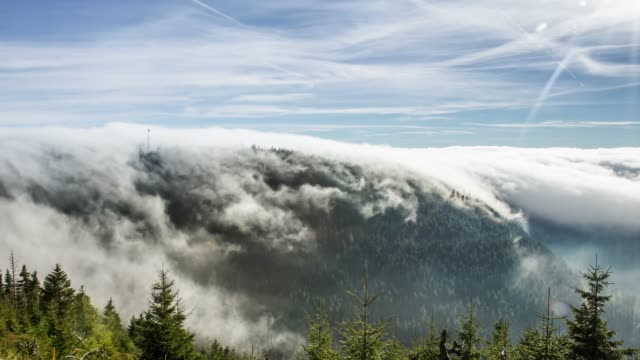 timelapse of fog rolling over mountain - roll over stock videos and b-roll footage