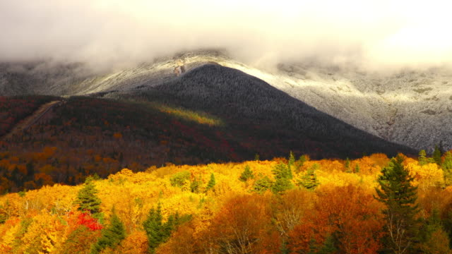 timelapse of foliage and snow in the mount washington valley - new england usa stock videos & royalty-free footage