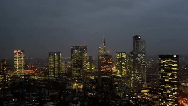 timelapse of frankfurt banking district skyline at night - dresdner bank stock videos and b-roll footage