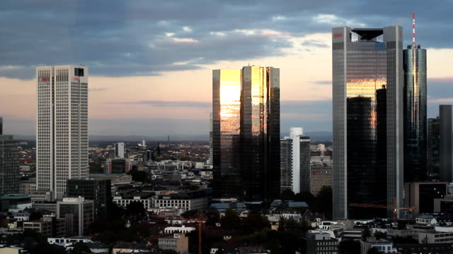 timelapse of frankfurt banking district skyline at sunset - frankfurt main stock videos and b-roll footage