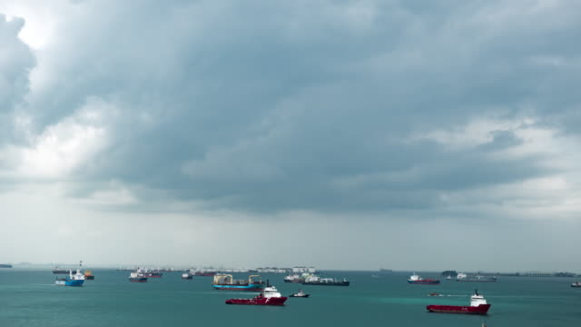 Timelapse of Freight ships at ocean and cloud