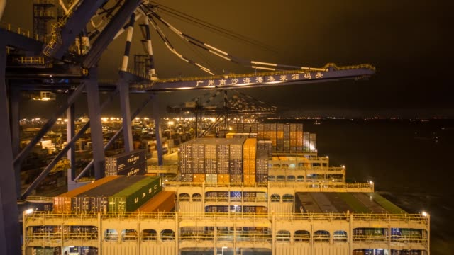 timelapse of gantry cranes loading shipping containers aboard the cma cgm sa's benjamin franklin container ship while docked at the xiamen songyu... - benjamin franklin stock videos & royalty-free footage