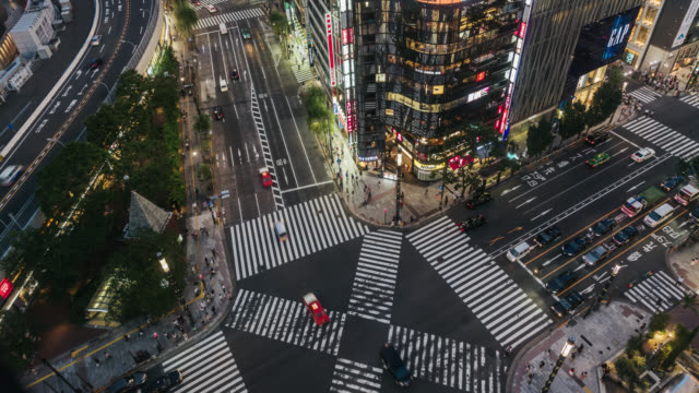 time-lapse of ginza cross - population explosion stock videos & royalty-free footage