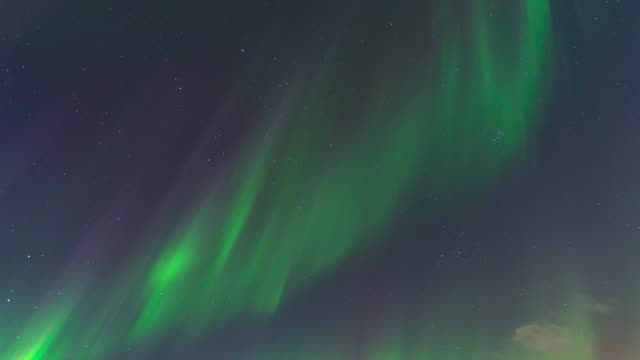 timelapse of green northern lights, aurora borealis, iceland, europe. - time-lapse - astronomie stock-videos und b-roll-filmmaterial