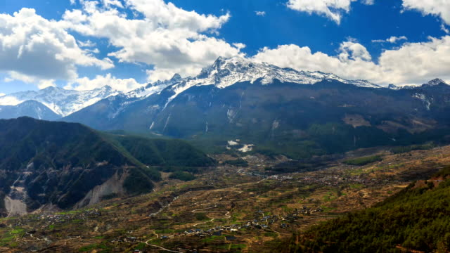 timelapse of haba snow mountain - yunnan province stock videos and b-roll footage