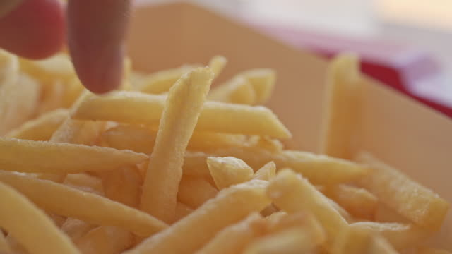timelapse of hand picking french fries - take away food stock videos & royalty-free footage