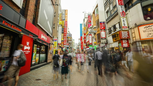 time-lapse of harajuku walking street - street name sign stock-videos und b-roll-filmmaterial