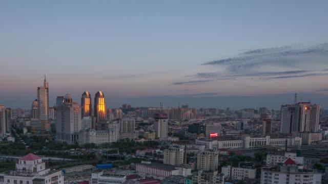 Timelapse of Harbin, China Cityscape Over Nightfall
