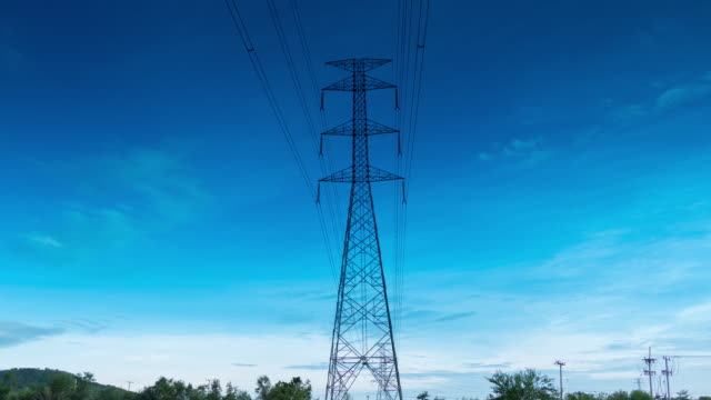 timelapse of high-voltage line under cloudy sky
