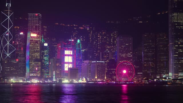 (zoom in) timelapse of hong kong central district at waterfront in night time. - zoom in stock videos & royalty-free footage