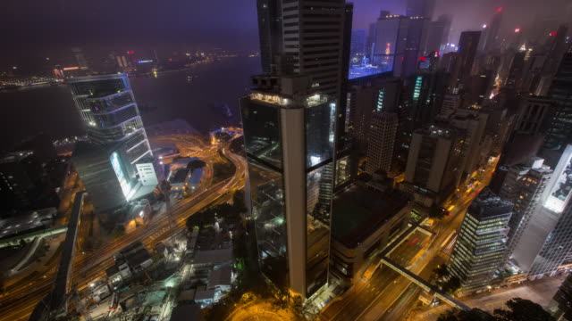 vídeos de stock, filmes e b-roll de timelapse of hong kong from skyrise - inclinando se