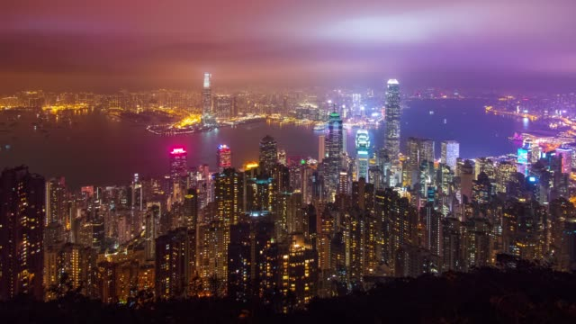 time-lapse of hong kong skyscraper and cityscape in night time. - victoria harbour hong kong stock videos & royalty-free footage