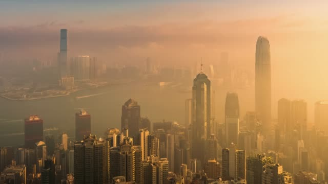 Time-lapse of Hong Kong skyscraper and cityscape in sunrise.