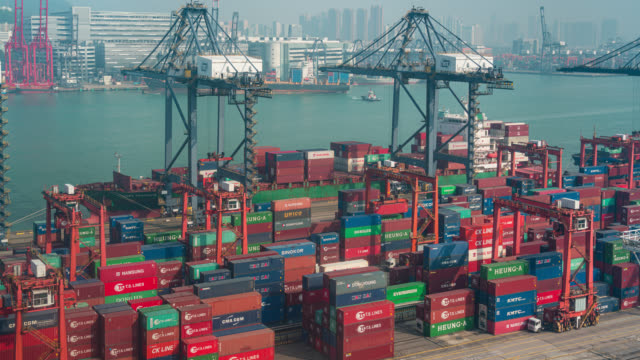 timelapse of international port with crane loading containers in import export business logistics at hong kong - container stock videos & royalty-free footage