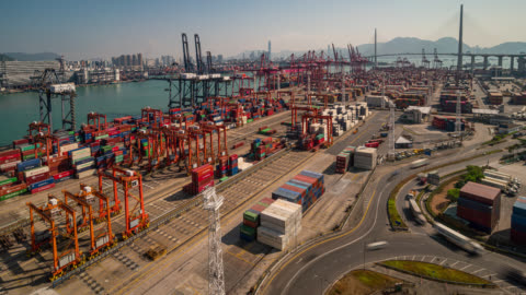 timelapse of international port with crane loading containers in import export business logistics at hong kong - hyper lapse stock videos & royalty-free footage