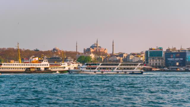 timelapse of istanbul cityscape galata bridge floating tourist boats in bosphorus ,istanbul turkey - yeni cami mosque stock videos & royalty-free footage