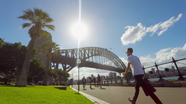 timelapse of joggers and pedestrians by the sydney harbour bridge - sydney stock videos & royalty-free footage