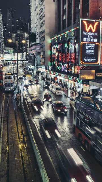 time-lapse of kings road in hong kong island at night. for vertical display - hong kong island stock videos & royalty-free footage