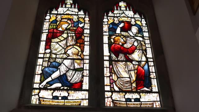 Timelapse of light shining through stain glass window