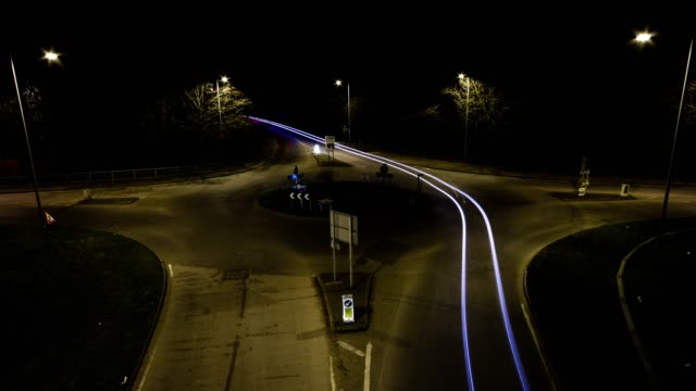 timelapse of light trails around a roundabout - light trail stock videos & royalty-free footage