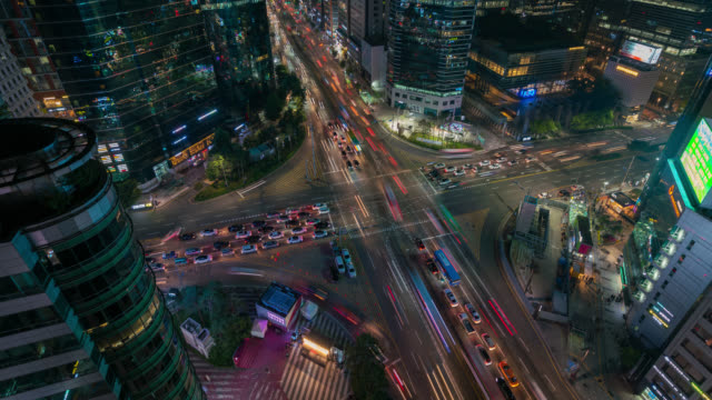 timelapse of light trails traffic speeds through an intersection in gangnam center business district of seoul at seoul city, south korea. - hyper lapse stock videos & royalty-free footage
