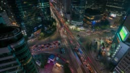 Timelapse of light trails traffic speeds through an intersection in Gangnam center business district of Seoul at Seoul city, South Korea.