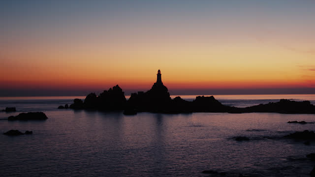 time-lapse of lighthouse at dusk - channel islands england stock videos & royalty-free footage