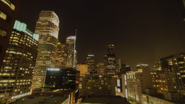 timelapse of lights turning on in skyscrapers in downtown los angeles, california, united states of america. - street light stock videos & royalty-free footage