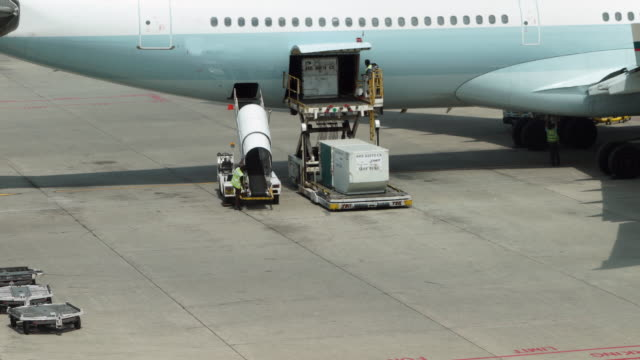 Timelapse of Loading cargo operation for commercial airplane
