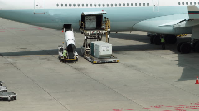 timelapse of loading cargo operation for commercial airplane - cargo aeroplane stock videos & royalty-free footage