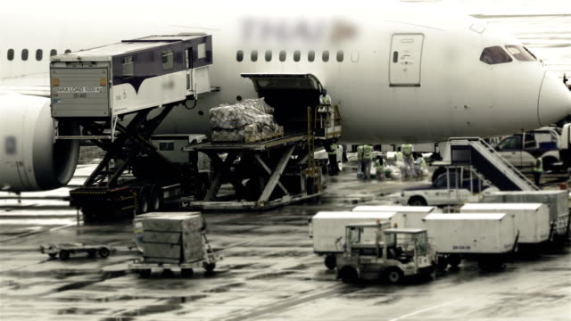timelapse of loading cargo operation for commercial airplane - unloading stock videos & royalty-free footage