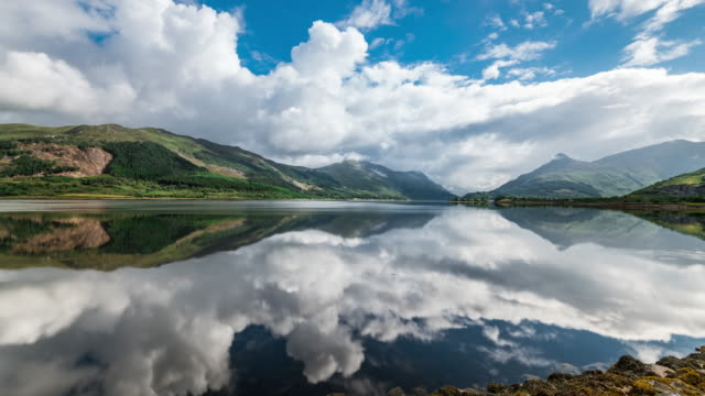 timelapse of loch leven mirror reflection - scottish highlands stock videos & royalty-free footage