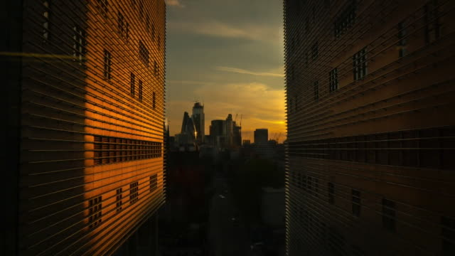 timelapse of london cityscape, daytime and sunset - film montage stock videos & royalty-free footage
