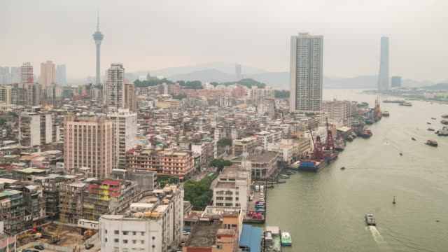 time-lapse of macau skyline aerial view macao china - macao flag stock videos and b-roll footage