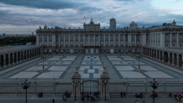 timelapse of madrid royal palace at sunset - courtyard stock videos & royalty-free footage