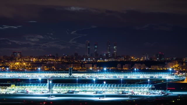 Time-lapse of Madrid Skyline and Barajas Airport Termina 4 at night