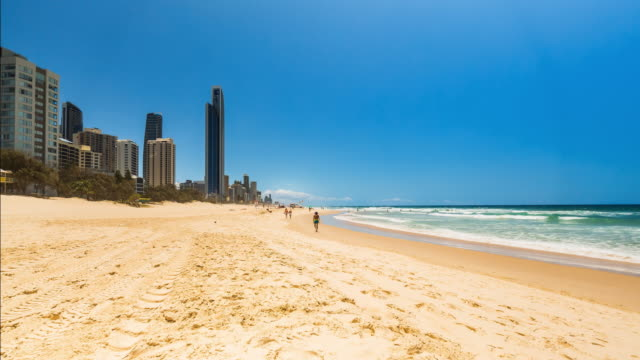 4K timelapse of main beach Surfers Paradise, with buildings, Gold Coast