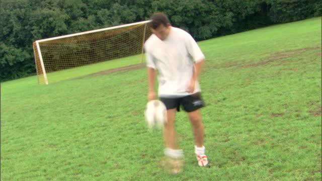 Time-lapse of man kicking soccer ball