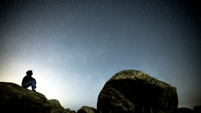 timelapse of man looking at night sky in ct - star space stock videos & royalty-free footage