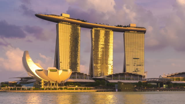 timelapse of marina bay sands at sunset, singapore - marina bay sands stock videos and b-roll footage