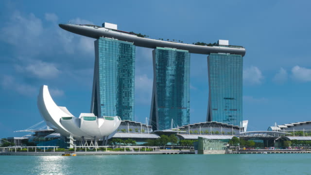 timelapse of marina bay sands during day, singapore - marina bay sands stock videos and b-roll footage