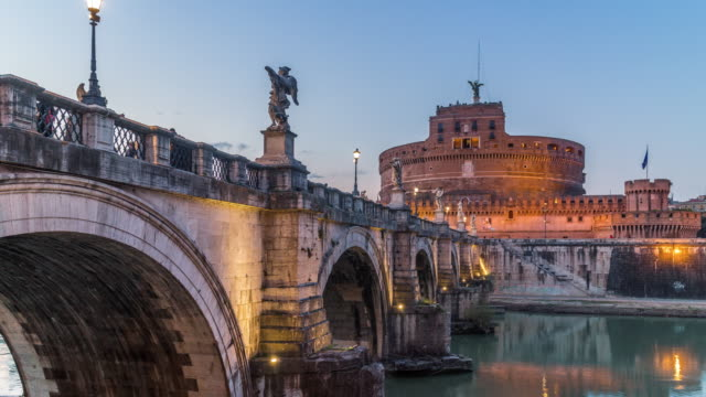 Timelapse of Mausoleum of Hadrian (Castel Sant'Angelo castel) with bridge at sunset. Rome, Italy. April, 2016.